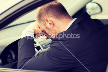 depositphotos_48646599-tired-businessman-or-taxi-car-driver